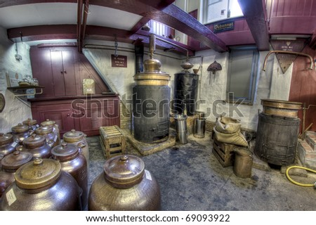 Small distillery for making gin in a small factory, in Dordrecht in the Netherlands - stock photo