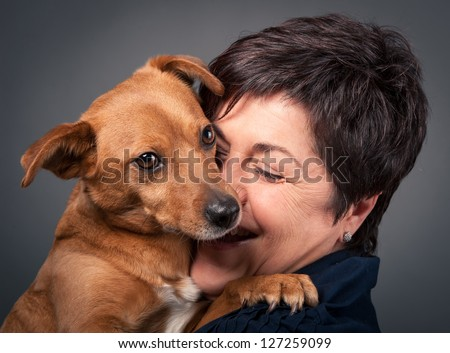 Small dog and middle age woman.