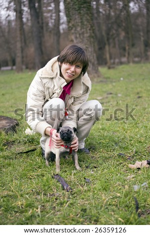 small dog with his beautiful owner - stock photo