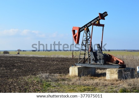 Small Donkey Pumper in a field - stock photo