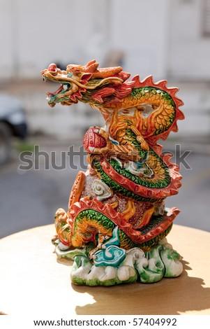 Small dragon statue - stock photo