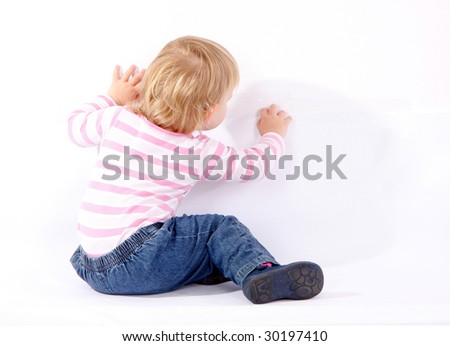 small drawing on wall young girl - stock photo