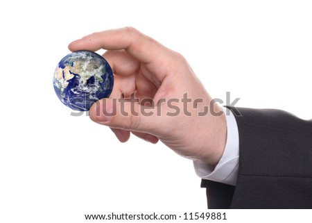 small earth in a hand on white background - stock photo