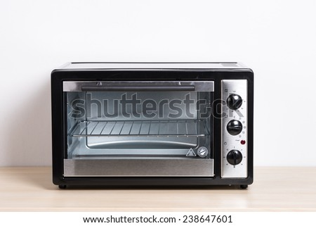 small electric oven isolated in the kitchen - stock photo