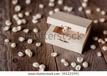 small empty wooden ring box on wooden background - stock photo