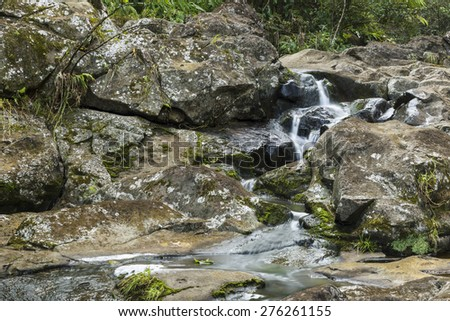 Small falls on the Waipio stream along the Road to Hana on Maui Island in Hawaii. - stock photo