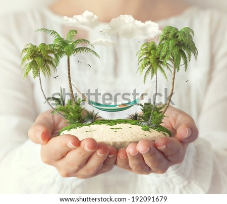 Small fantastic island with a hammock and palms in women's hands. - stock photo