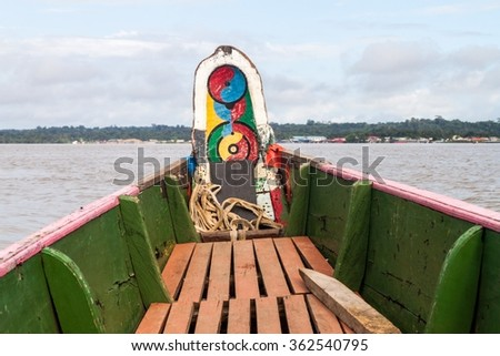 Small ferry crossing Maroni (Marowijne) river (to Suriname) in St Laurent du Maroni, French Guiana. - stock photo