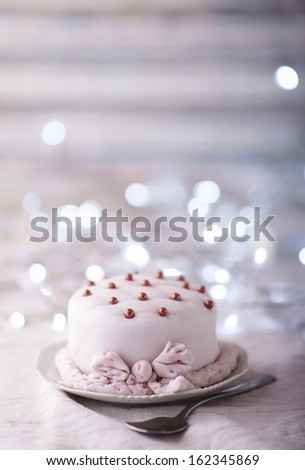 Small festive cake decorated with pearls - stock photo