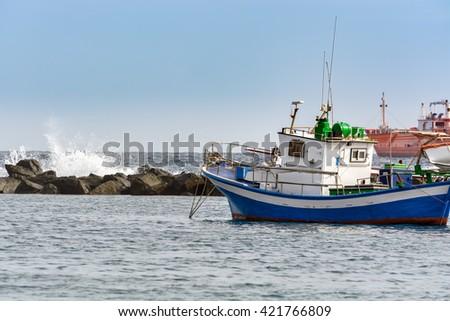 Small fishing boat at an ocean port of Santa Cruz town on Tenerife island, Spain. - stock photo