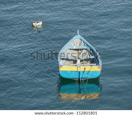 Small fishing boat floating in the fish port of Cascais - Portugal - stock photo