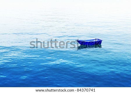 small fishing boat floating on blue sea - stock photo