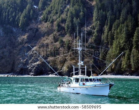 Small fishing boat in Alaska in a fjord - stock photo