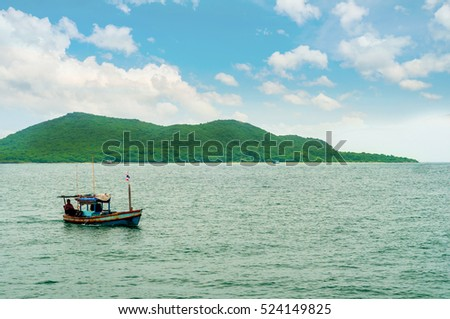 Small fishing boat in front of Green island in South of Thailand in Siam Gulf (Koh Chang)
