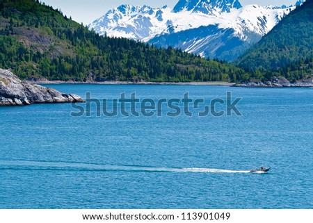 Small fishing boat in the harbor of the Glacier Bay National Park, Alaska - stock photo