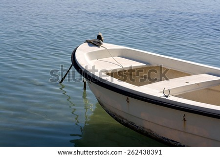 Small fishing boat in the sea, focus on details. - stock photo