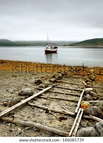 Small fishing boat, in the village of Norway - stock photo