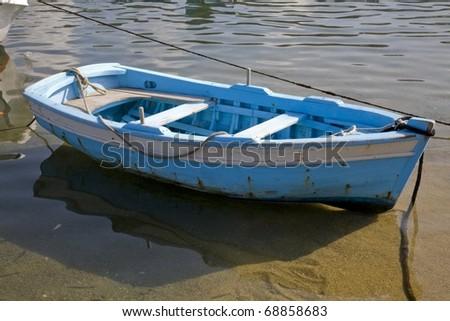 Small fishing boat near the beach in Mykonos, Greece - stock photo