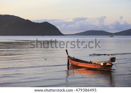Fishing boat anchored near sandy shallow stock photo for Fishing docks near me