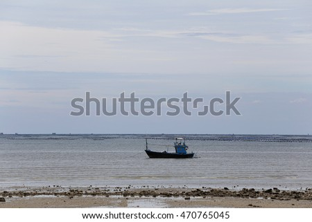 Small fishing boats in seaside of Coast on time low tide and sky background.