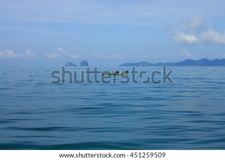 Small fishing boats in the sea.select focus.soft focus the field for foreground.