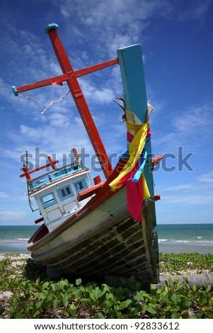 Small fishing boats on the beach in Phetchaburi - stock photo