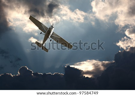 Small fixed wing plane against a stormy sky - stock photo