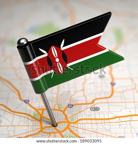 Small Flag of Kenya on a Map Background with Selective Focus.