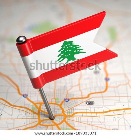 Small Flag of Lebanon on a Map Background with Selective Focus. - stock photo