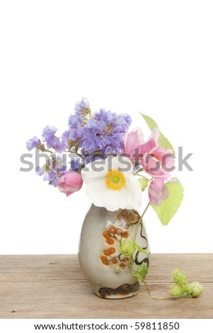 Small flower arrangement in a pottery vase