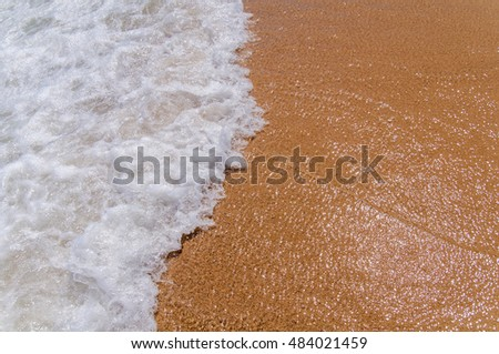 Small foam wave on sea close with beach