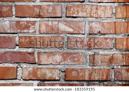 Small fragment of damaged  wall of bricks. - stock photo