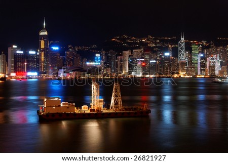 Small freight ship in Hong Kong at night - stock photo