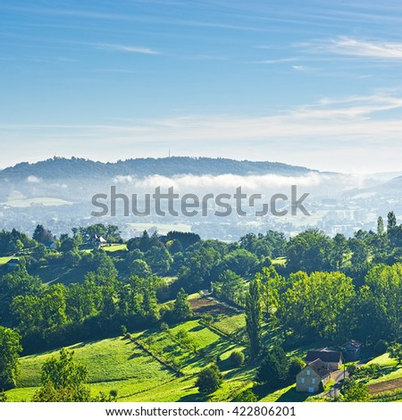 Small French Village in the Morning Mist - stock photo