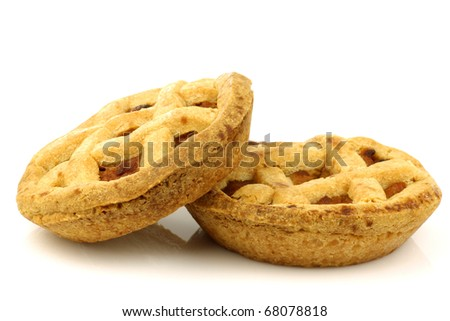 small fresh and decorated apple pies on a white background - stock photo