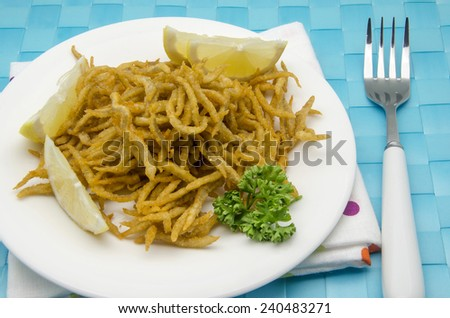 Small fried whitebait served on a plate