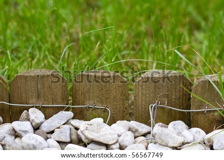 Small garden picket fence - stock photo
