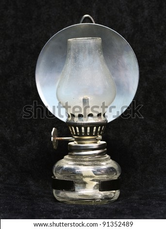 Small gas lamp on black background - stock photo