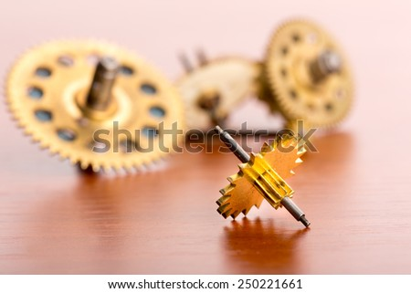 Small gears on the table - stock photo