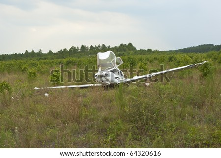 Small general aviation aircraft crash lands in a field - stock photo