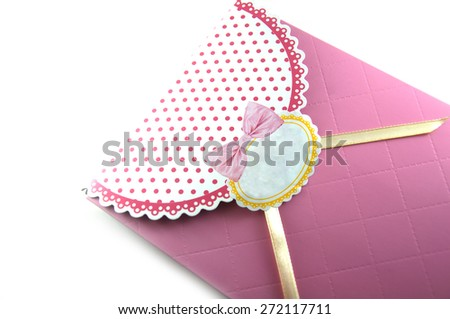 small gift box with decoration on white - stock photo