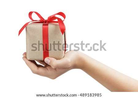 small gift box wraped in recycled paper with ribbon bow on female teen hand