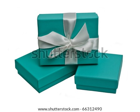 Small gift boxes on white background - stock photo