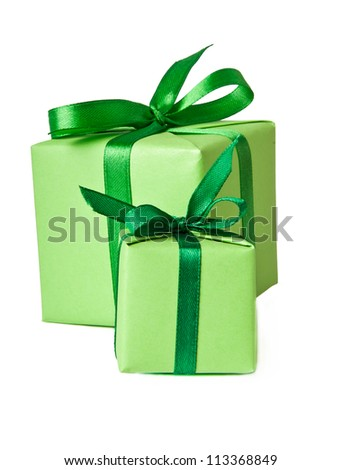 small gifts with green ribbon on a white background - stock photo