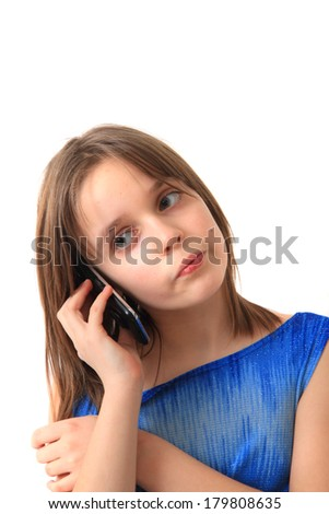 small girl and cell phone isolated on the white background - stock photo