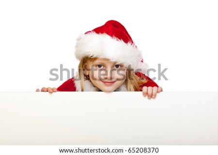 Small girl dressed as santa claus holds blank advertisement sign. Isolated on white background. - stock photo