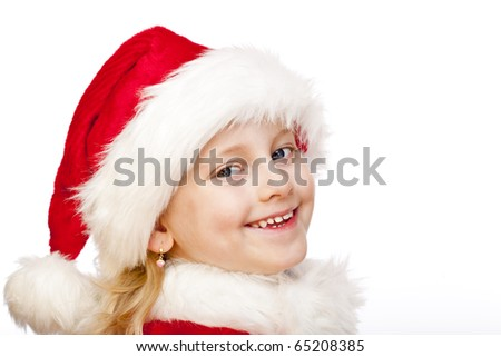 Small girl dressed as santa claus smiles happy into camera. Isolated on white background. - stock photo