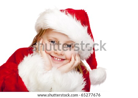 Small girl dressed as santa claus smiles happy.  Isolated on white background. - stock photo