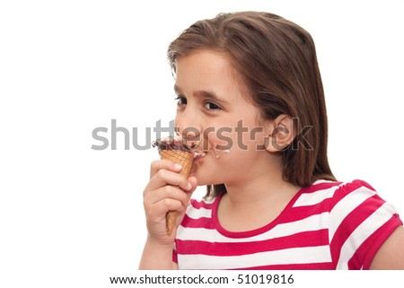 Small girl eating an ice cream cone on a white background