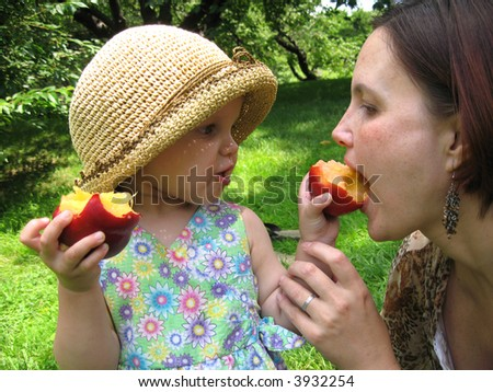 small girl feed her mother - stock photo